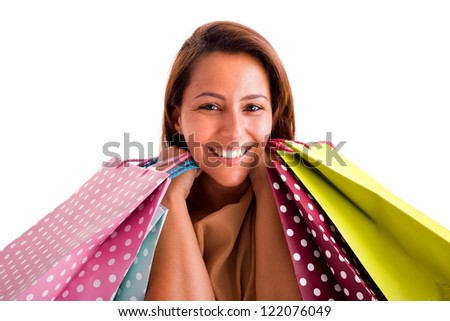 Portrait of a happy smiling woman holding shopping bags against white background