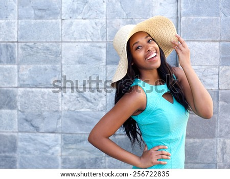 Portrait of a happy smiling young woman with sun hat - stock photo