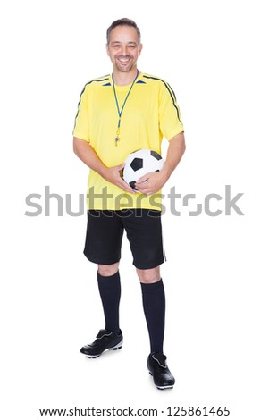 Portrait Of A Happy Soccer Player With A Football Against White Background - stock photo