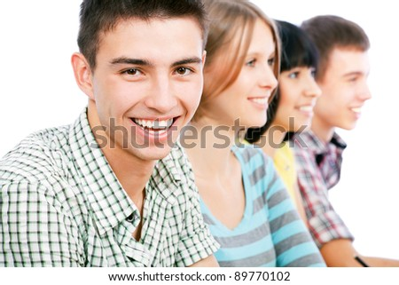 Portrait of a happy student and his friends - stock photo