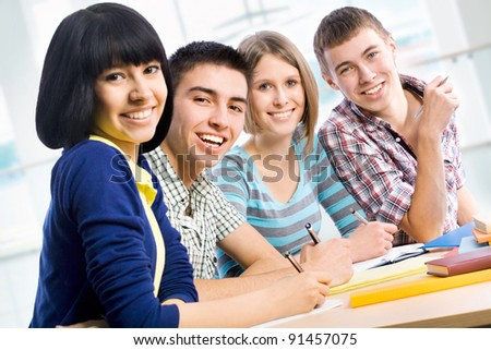 Portrait of a happy students - stock photo