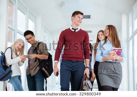 Portrait of a happy students in university hall  - stock photo