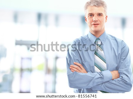 Portrait of a happy successful mature business man - stock photo