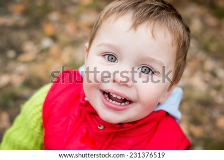 Portrait of a happy toddler child playing - stock photo