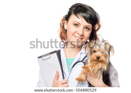 portrait of a happy veterinarian and Yorkshire terrier on a white background