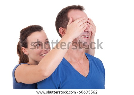 Portrait of a happy woman covering his man eyes, to surprise him - stock photo