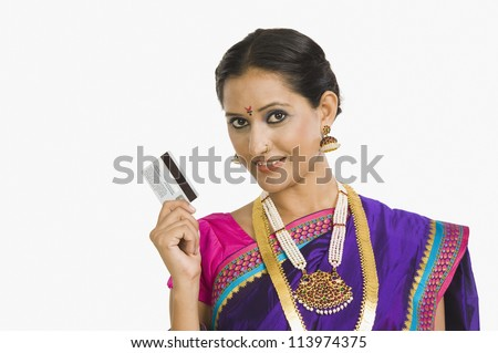 Portrait of a happy woman holding a credit card - stock photo