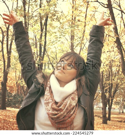 Portrait of a happy woman in autumn forest  - stock photo