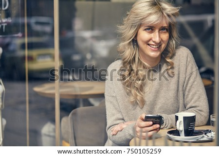 Portrait of a happy woman looking at the phone and very joyful