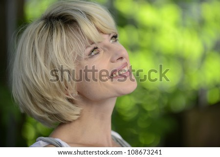 Portrait of a happy woman outdoors with copyspace - stock photo