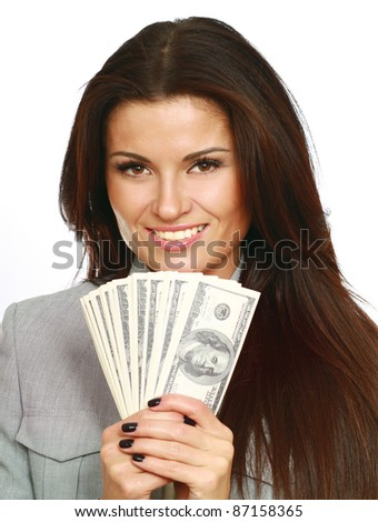 Portrait of a happy woman with a fan of American dollar - stock photo