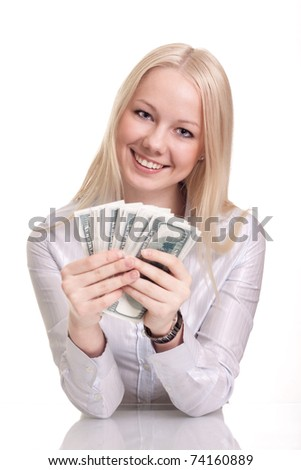Portrait of a happy woman with a fan of American dollar currency notes , white background