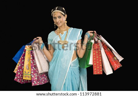 Portrait of a happy woman with shopping bags - stock photo