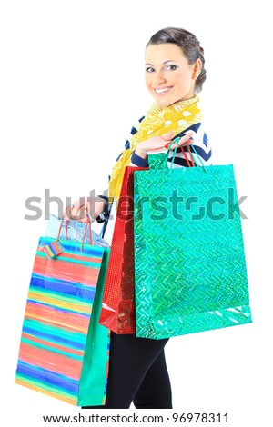 Portrait of a happy young adult girl, with color-coded bags.