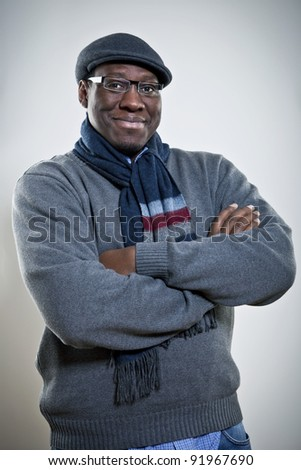 Portrait of a happy young African American man with hands folded