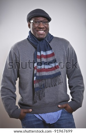 Portrait of a happy young African American man with hands in pockets