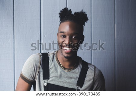 Portrait of a happy young afroamerican indoors with afro hairstyle