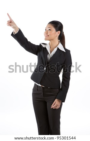 Portrait of a happy young Asian business woman pointing. Isolated on a white background - stock photo