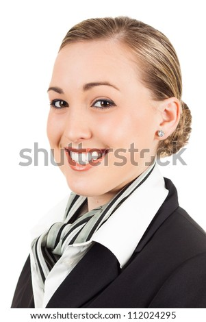 Portrait of a happy young beautiful air hostess. Isolated over white. - stock photo