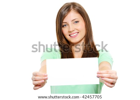 Portrait of a Happy young beautiful female holding blank card - over white background - stock photo