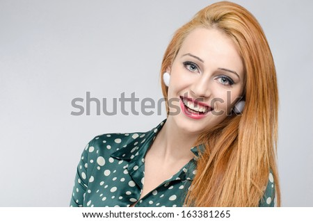 Portrait of a happy young beautiful woman. Girl with red hair smiling.