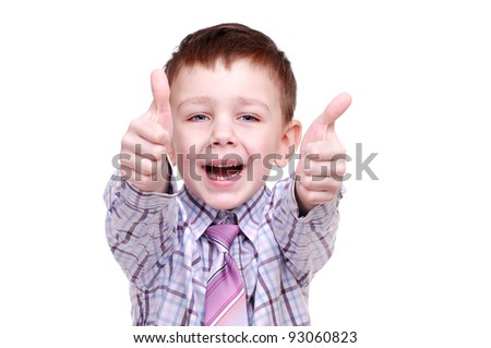 Portrait of a happy young boy showing thumbs up on a white background