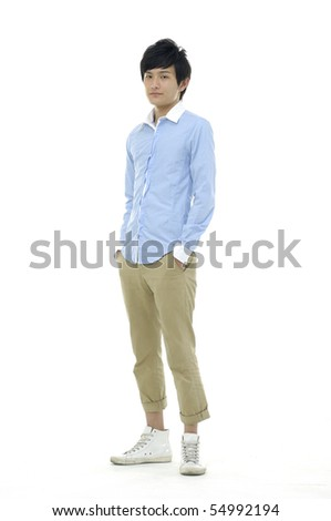 Portrait of a happy young boy standing against isolated - stock photo
