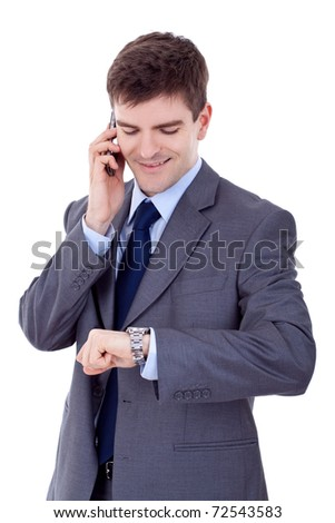 Portrait of a happy young business man checking time while speaking on cellphone - stock photo