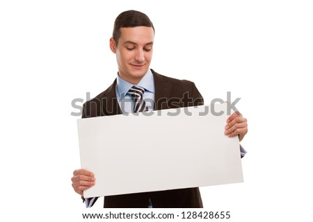 Portrait of a happy young business man holding a blank board for texting against white - stock photo