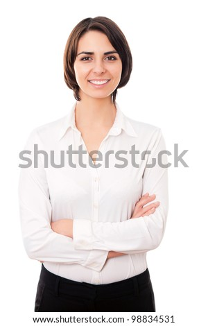 Portrait of a happy young business woman pointing at something interesting against white background - stock photo