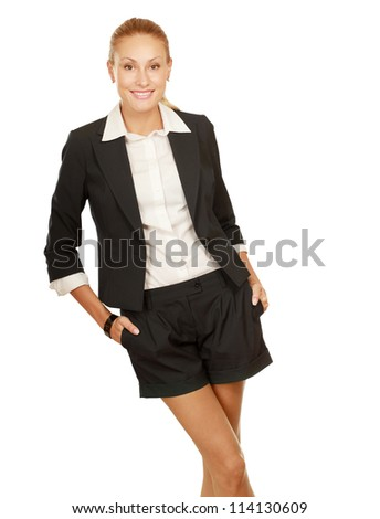 Portrait of a happy young business woman standing, white background - stock photo