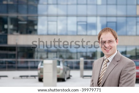 Portrait of a happy young businessman outdoor the office - stock photo