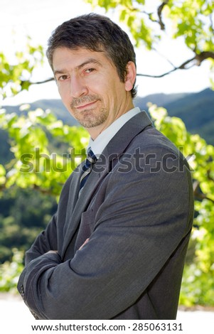 portrait of a happy young businessman, outdoors - stock photo