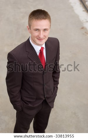 Portrait of a happy young businessman, smiling