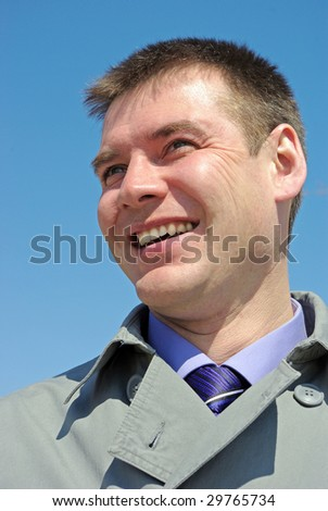 Portrait of a happy young businessman, smiling, indoor