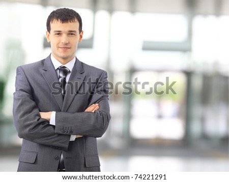 Portrait of a happy young businessman, smiling, indoor - stock photo