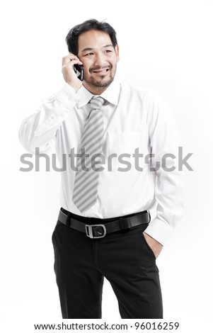 portrait of a happy young businessman talking on mobile phone - stock photo