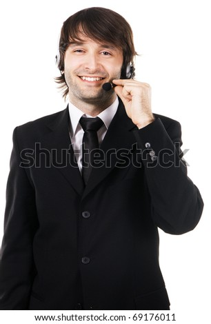 Portrait of a happy young businessman with headset on white background