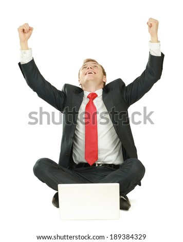 Portrait of a happy young businessman working on laptop against white background - stock photo