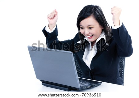 Portrait of a happy young businesswoman cheering in front of laptop, over white background.