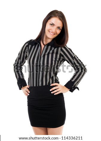 Portrait of a happy young businesswoman standing with hands on hips, isolated on white