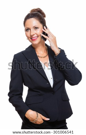 Portrait of a Happy Young Businesswoman Wearing Black Suit, Calling Someone on Mobile Phone. Isolated on White Background.
