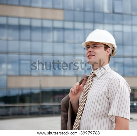 Portrait of a happy young construction engineering worker/manager - stock photo
