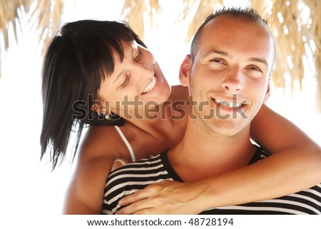 Portrait of a happy young couple enjoying summer holidays.