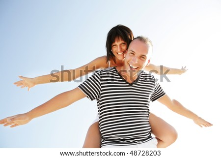 Portrait of a happy young couple having fun outdoors.