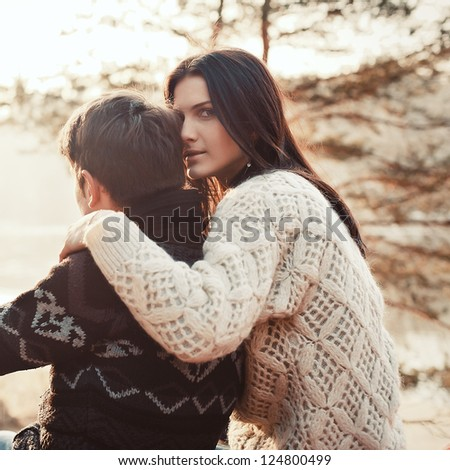 Portrait of a happy young couple hugging each other at the beach - stock photo