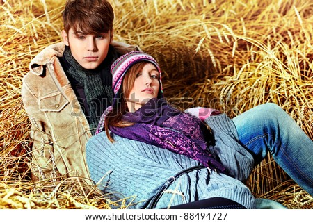 Portrait of a happy young couple in warm clothes outdoor.