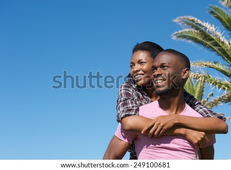 Portrait of a happy young couple smiling enjoying summer together - stock photo