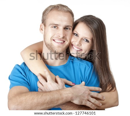 portrait of a happy young couple smiling, looking - isolated on white - stock photo