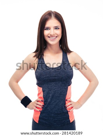 Portrait of a happy young fitness woman standing isolated on a white background and looking at camera - stock photo